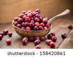 Cranberries In Wooden Bowl On...