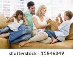 family sitting in living room...   Shutterstock . vector #15846349