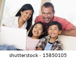 family in living room with... | Shutterstock . vector #15850105