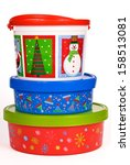 Stack of three Christmas Holiday Cookie Containers isolated on white - stock photo