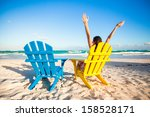 Young Woman In Beach Chair...