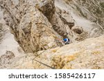 Small photo of Climbing via via ferrata - Italian Alps. Mountain tourism in the Dolomites.