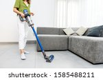 Woman cleaning floor with...
