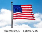 usa flag in front of the sun | Shutterstock . vector #158607755