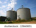Two huge grain silos dominate the skyline - stock photo