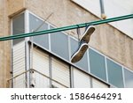 Shoes Hang On An Electric Wire...