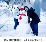 Young Couple With Snowman...