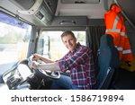 Truck Driver In Cab Of Semi...
