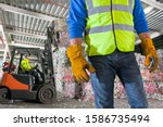 Close Up Of Worker With...