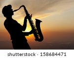 Saxophonist. Woman Playing On...