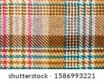 Brown Checkered Fabric With...
