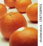 Small photo of Still life of whole oranges on white background