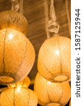 Small photo of Group of rustic lamps pending from the roof