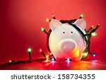 piggy bank wrapped in christmas ... | Shutterstock . vector #158734355