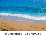 sandy beach and sea | Shutterstock . vector #158789159