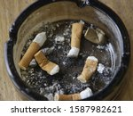 Small photo of Close up of ashtray with cigarette butts