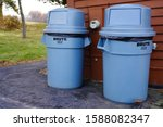 Small photo of Fond du Lac, Wisconsin / USA - November 24th, 2019: Rubbermaid Commercial vented BRUTE Trash bin container sits outside for residents to use to place their trash in.