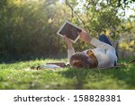 woman lying on bedding on green ... | Shutterstock . vector #158828381