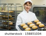 happy female baker showing some ... | Shutterstock . vector #158851034