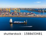 Small photo of Helsinki. Finland. Barge is sailing a cargo port. Trading port in Helsinki. Cargo delivery to Finland by sea. Barge arrived to load. Imports of goods to Finland. Export and the European Union. Ship
