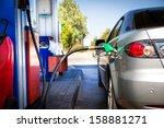 car refueling on a petrol... | Shutterstock . vector #158881271