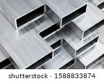 Small photo of Aluminium profile for windows and doors manufacturing. Structural metal aluminium shapes. Aluminium profiles texture for constructions. Aluminium constructions factory background.