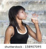 woman athlete drinking water | Shutterstock . vector #158907095