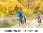 happy family on bikes in autumn ... | Shutterstock . vector #158924201