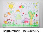 Child drawing a happy family in ...