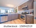 modern kitchen in luxury house. | Shutterstock . vector #158942519