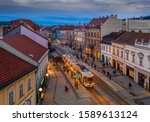 Miskolc, Hungary - Festively decorated Christmas light tram and traditional houses at the high-street of Miskolc, Borsod-Abauj-Zemplen county at dusk