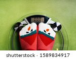 Girl Standing On The Scales In...
