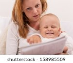 young mother is drawing with... | Shutterstock . vector #158985509