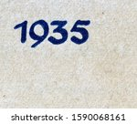 The year 1935 printed in blue on the dust jacket of a journal published that year, the texture of the paper being visible