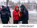 Small photo of Perm, Russia - December 14, 2019: russian police officers check for prohibited items of citizens going to an authorized rally