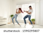 Beautiful Young Couple Dancing...