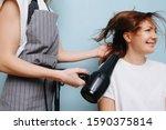 Female Hairdresser In Apron...