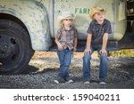 Two Young Boys Wearing Cowboy...