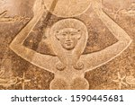 Small photo of Africa, Egypt, Cairo. October 4, 2018. Carved stone relief of the goddess Hathor with a sun disk. Hathor was a major goddess symbolizing maternal aspects.