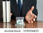 businessman man to sell house | Shutterstock . vector #159056825