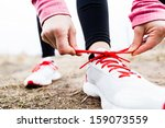 Woman Runner Tying Sport Shoes...