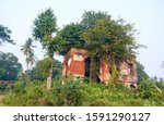 Small photo of Budge Budge, West Bengal, 12/15/2019: Ancient ruins of the Achipur Barood Ghar, officially known as the Achipur Powder Magazine. A few hundred years old building still stands tall despite negligence.