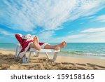 sunbathing santa claus relaxing ... | Shutterstock . vector #159158165