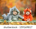 Two Baby Boys Dressed In Animal ...