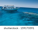 boat diving on the reef | Shutterstock . vector #159173591