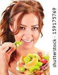Young woman eating fruit salad - stock photo