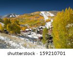 Snow On Golden Aspen Trees At...