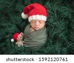 Adorable Newborn In Santa Hat...