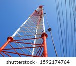 Lightning rod or ground wire on the tower Installed on the radio communication pole structure On the blue sky background and cable. - stock photo