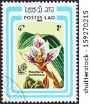 """Small photo of LAOS - CIRCA 1985: A stamp printed in Laos from the """"Argentina '85 International Stamp Exhibition, Buenos Aires. Orchids"""" issue shows Maxillaria sanderiana, circa 1985."""